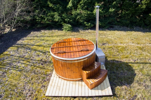 Wooden hot tub with steps