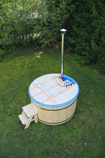 Budget fiberglass wooden hot tub in a garden