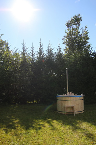 Fiberglass wooden hot tub barrel and virgin nature
