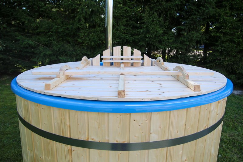 barrel hot tub with fire heater in the garden