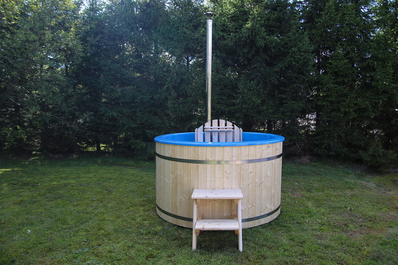 Fiberglass wooden hot tub with wood burning heater in garden
