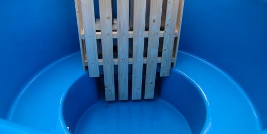 Fiberglass hot tub with wood burning heater
