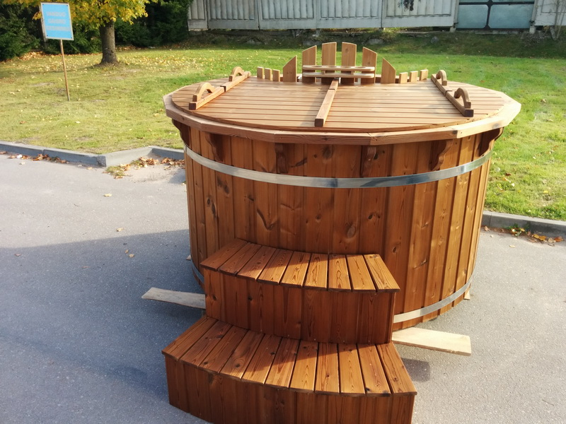 Old fashioned new stainless steel wooden hot tub