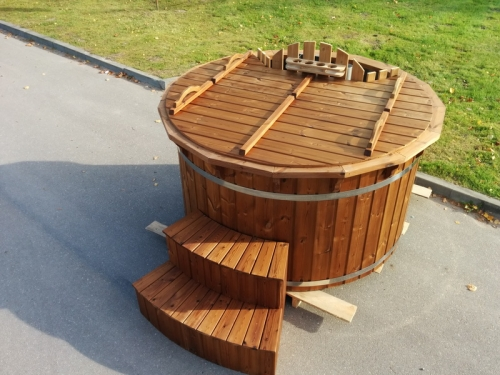 Old fashioned stainless steel wooden hot tub