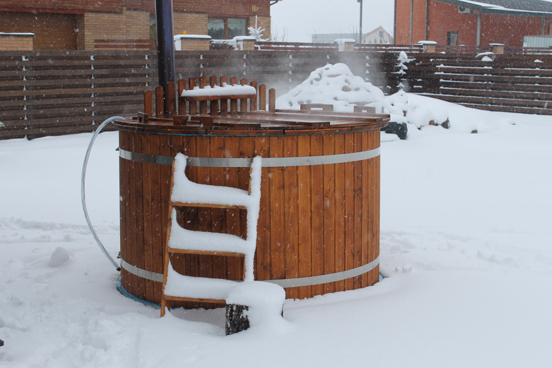Garden outdoor wooden hot tub in winter